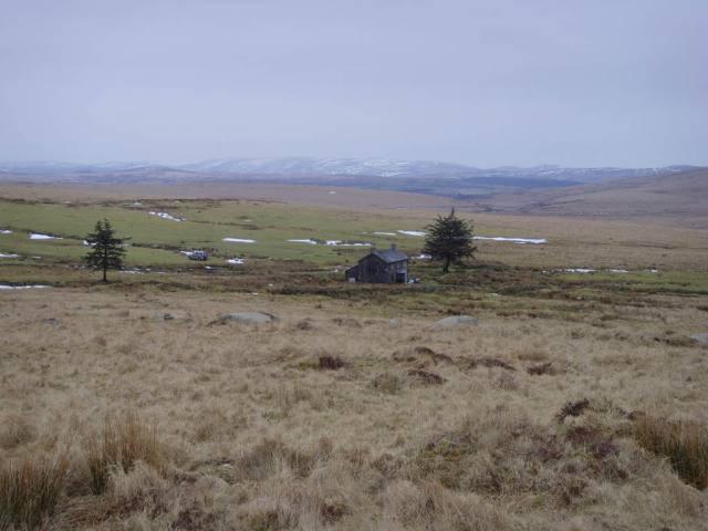 Nun's Cross nestling against the backdrop of a majestic Dartmoor landscap